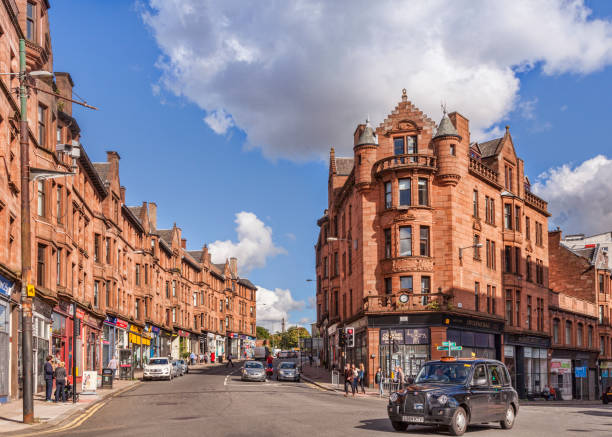 Glasgow, Scotland, Red Sandstone Tenements and Taxi Cab, Sunny Day stock photo