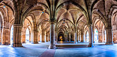 'The Cloisters' - actually an 'undercroft' - below the Bute Hall in Glasgow University.  Constructed by George Gilbert Scott in Gothic style in the 1870s.  Very wide angle view.