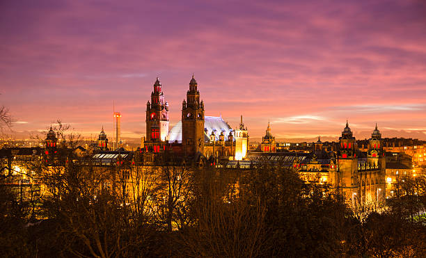 Glasgow West End Looking over Glasgow's west end from the university after sunset. The Science Tower and the towers of the Kelvingrove Art Gallery stand out on the skyline. theasis stock pictures, royalty-free photos & images