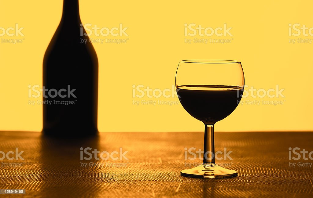 Glass and bottle backlit royalty-free stock photo