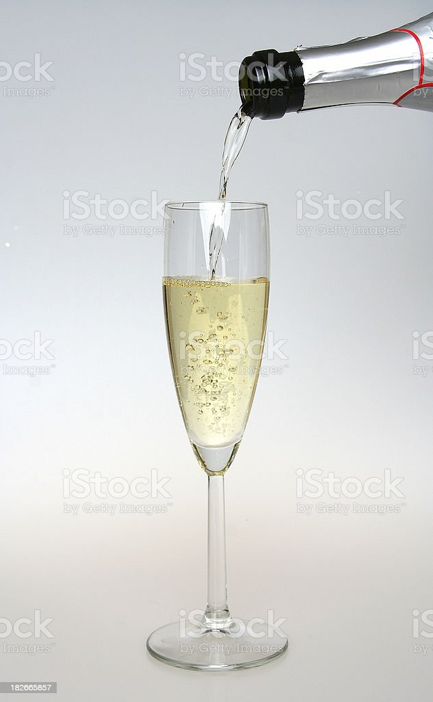 Glass and bottle of champagne royalty-free stock photo