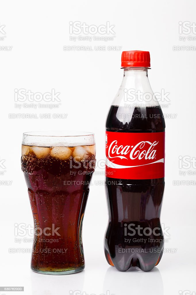 Glass and bottle of Coca-Cola. Isolated on white Background. stock photo