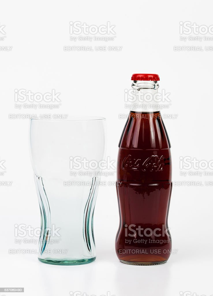 Glass and bottle of Coca-Cola. stock photo
