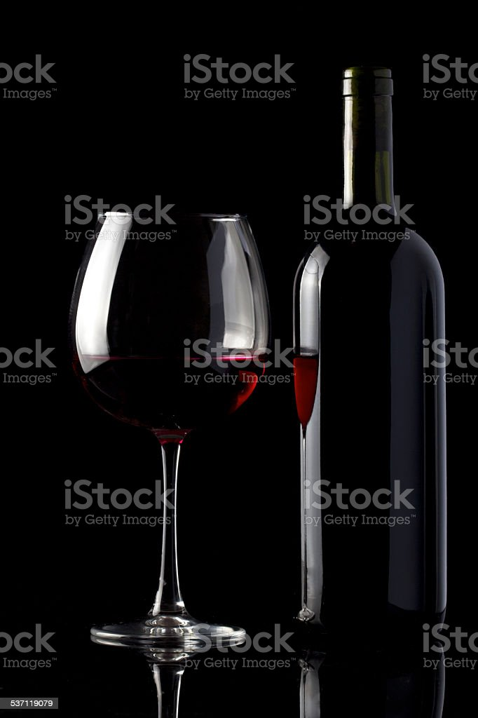 Glass and Bottle of Red Wine on Black stock photo