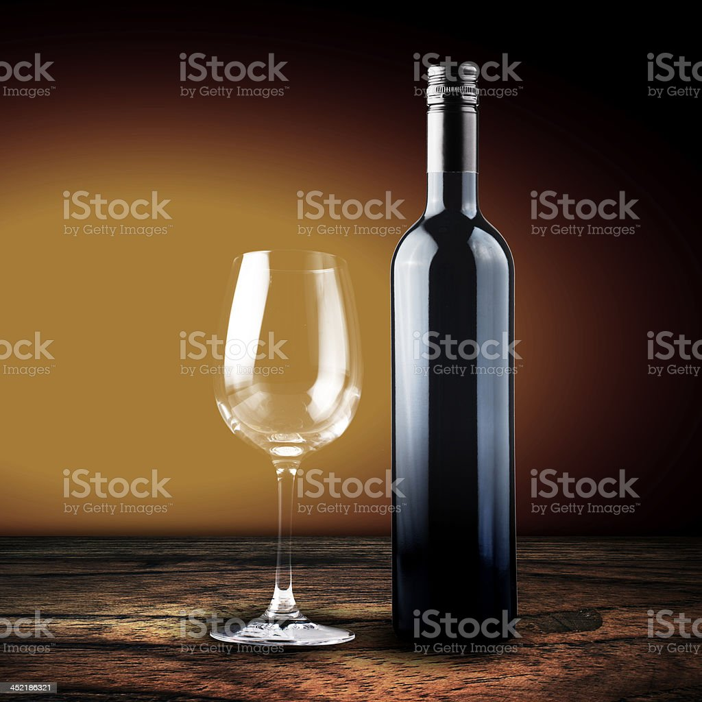 Glass and bottle of red wine on wood table royalty-free stock photo