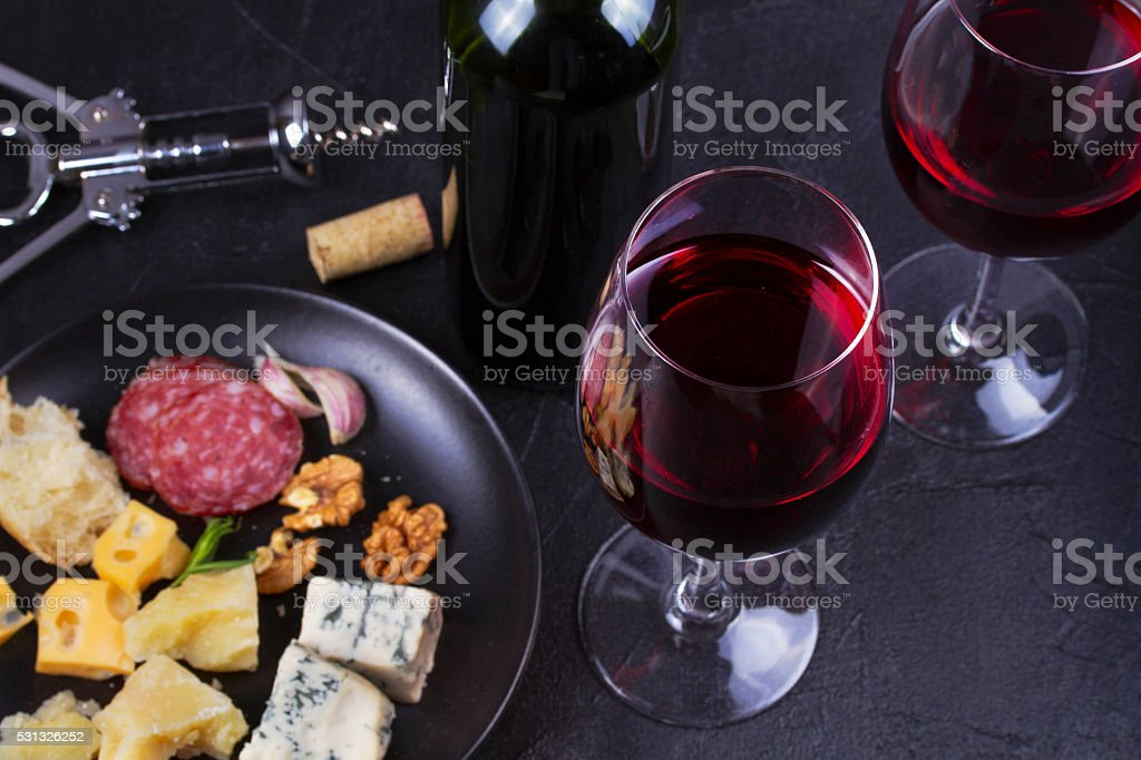 Glass and bottle of red wine stock photo