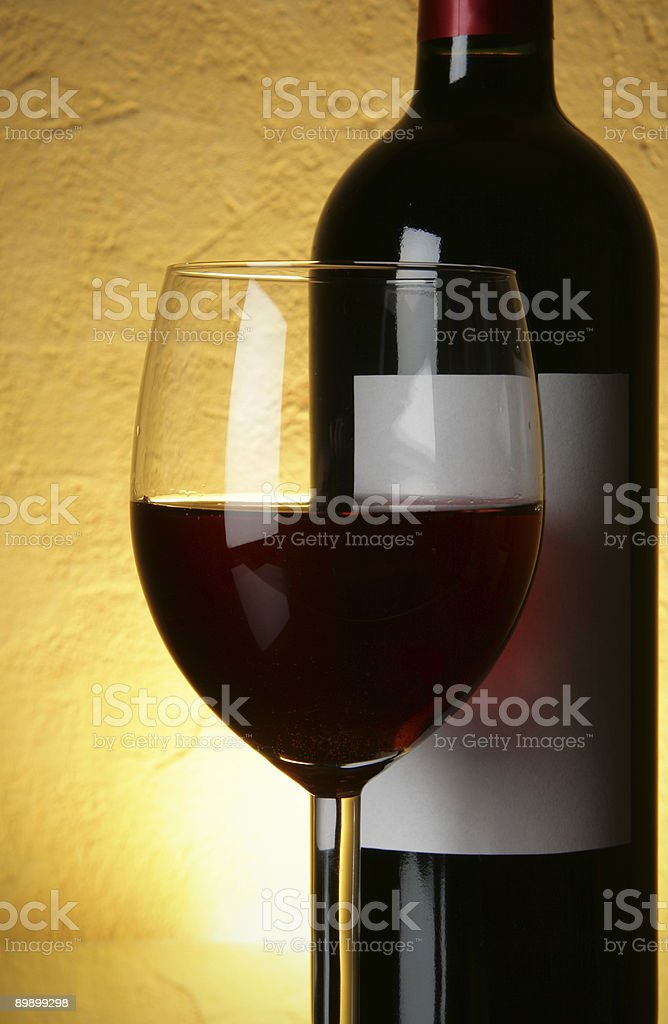Glass and bottle of red wine royalty free stockfoto