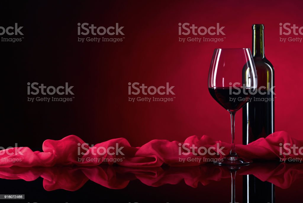 Glass and bottle of red wine. stock photo