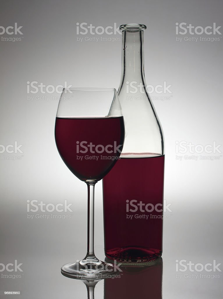 Glass and bottle with red wine. royalty-free stock photo