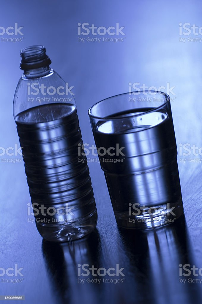 Glass and bottled water stock photo