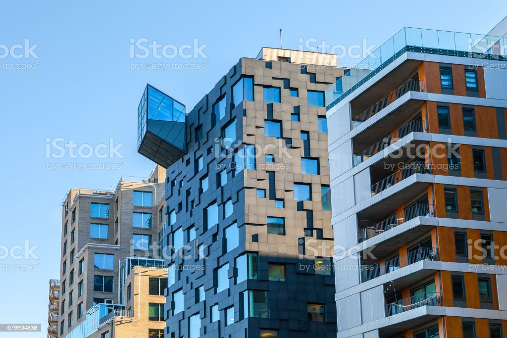 OSLO, NORWAY - 27 FEB 2016: Glass and concrete architectural exteriors. Ultra modern buildings. stock photo