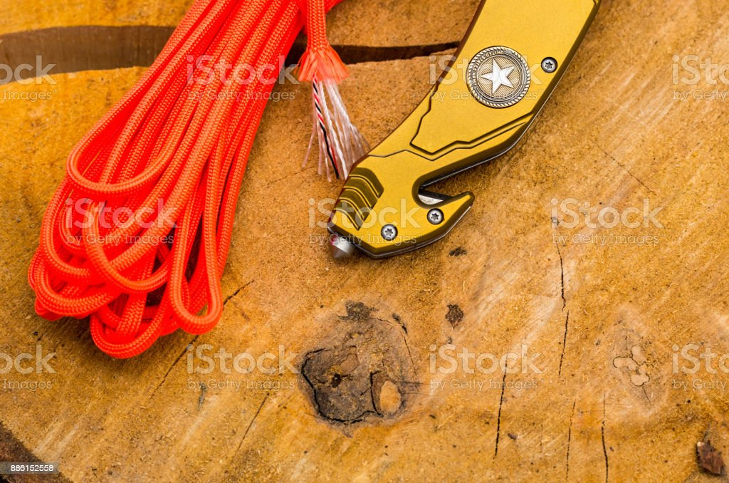 Glass and cutter for survival in emergency situations in a pocket knife. stock photo