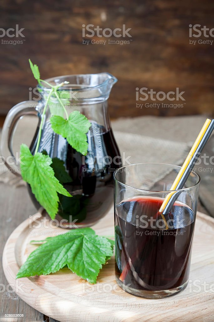 Glass and jug with fresh Black Currant juice stock photo