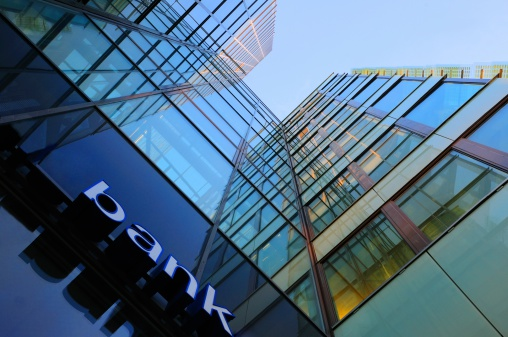 Bank corporate finance building seen from below. The sign