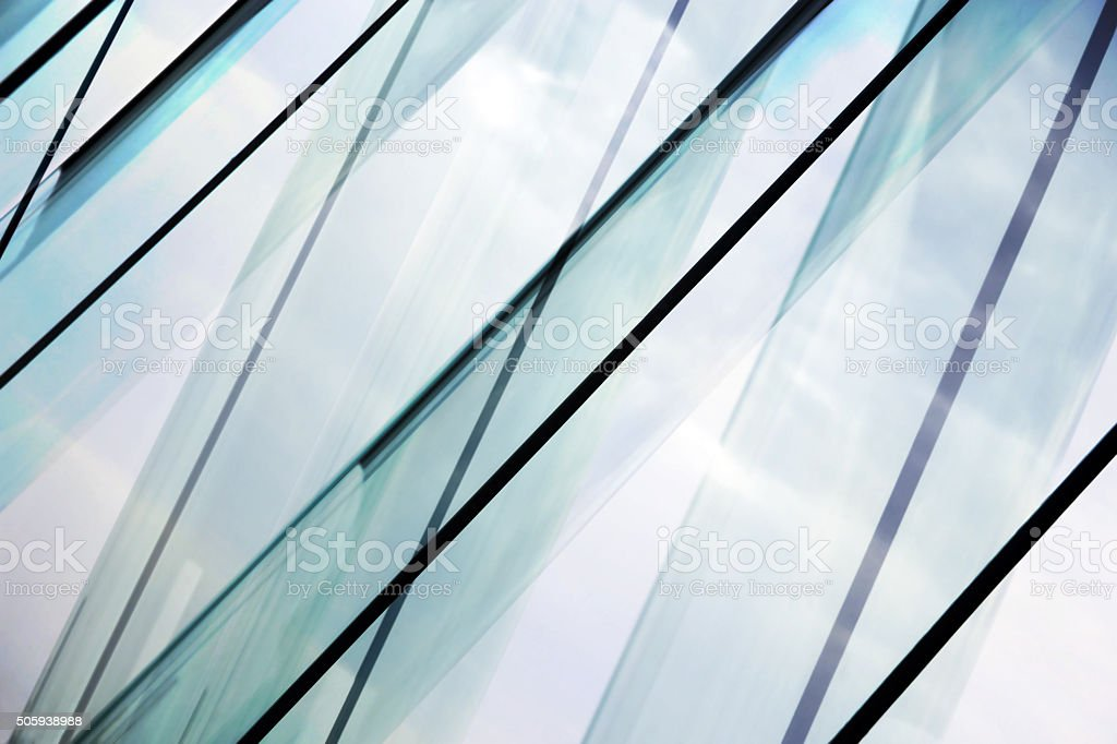 Glass architecture. Double-exposure tilt photo of contemporary office building facade. royalty-free stock photo