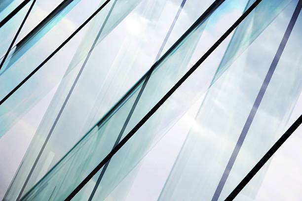 Glass architecture. Double-exposure tilt photo of contemporary office building facade. stock photo