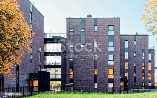 1165384568 istock photo EU Glass architecture of modern residential apartment building 1163584700