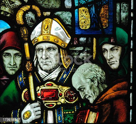 Very old stained glass window depicting St Patrick taken in County Cork Ireland