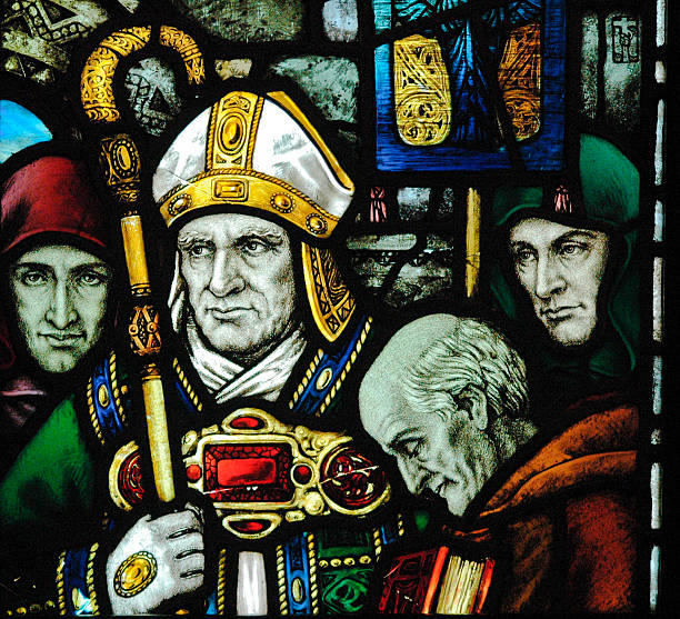 Glass art of Saint Patrick close-up Very old stained glass window depicting St Patrick taken in County Cork Ireland religious saint stock pictures, royalty-free photos & images
