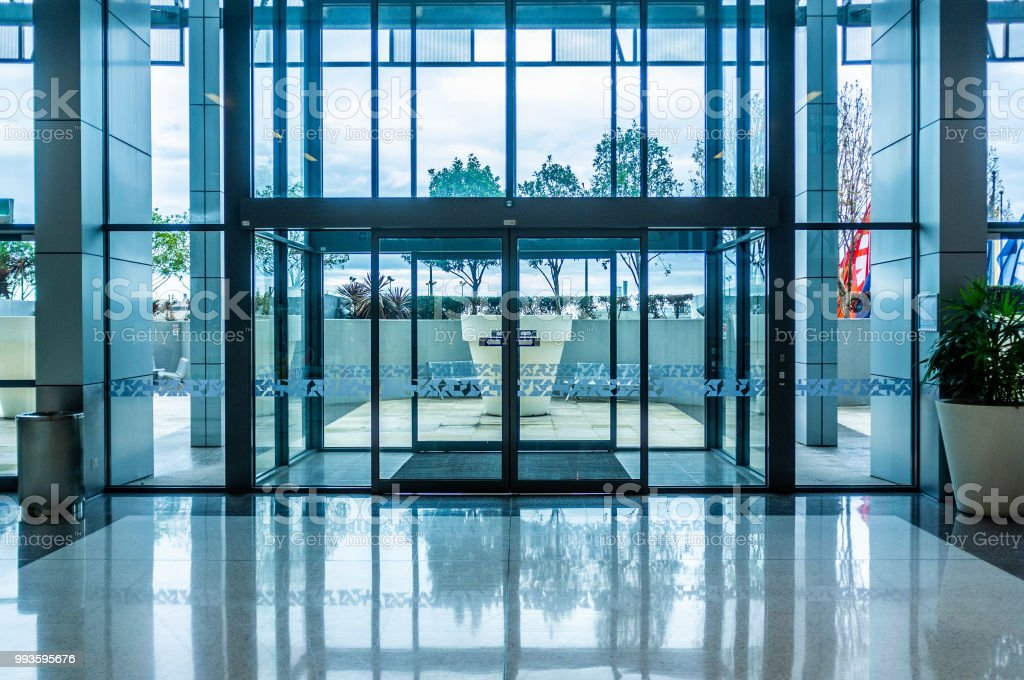 Glass automatic sliding doors entrance into shopping mall stock photo