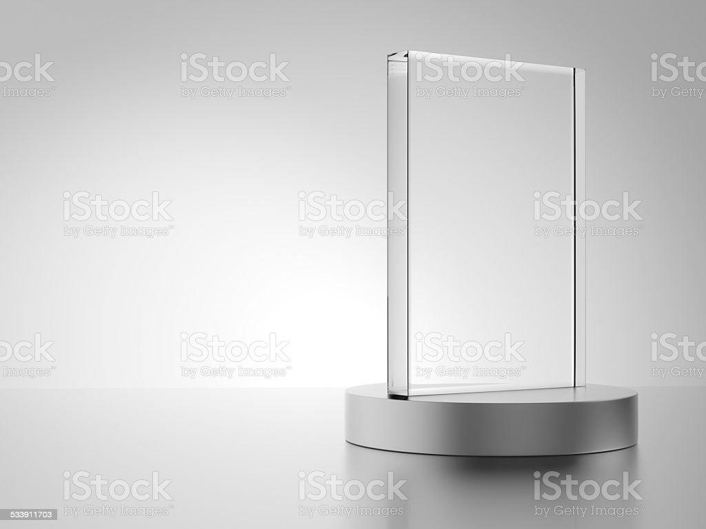 Glass award with metal base stock photo