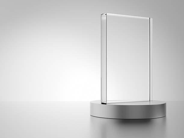 glass award with metal base - trophy award stock photos and pictures