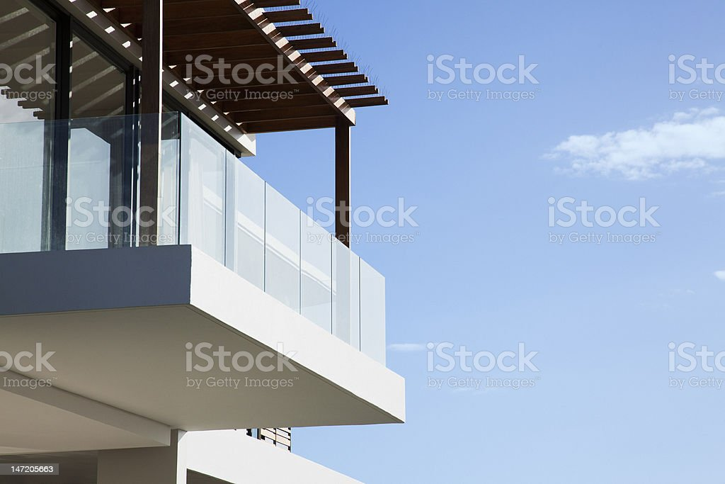 Glass balcony on modern house stock photo