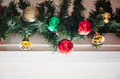 istock glass ball and decorations on Christmas tree.Garland with lights and red-green, gold balls on a white background 1173024817