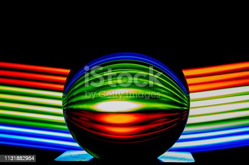 istock Glass ball light painting - blue stripes 1131882954
