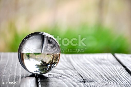 Glass or crystal ball on a wood table in the garden