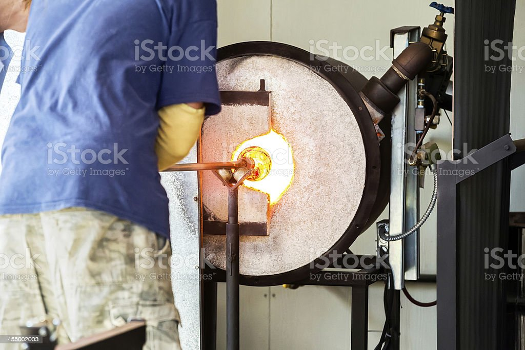 Glass blower demonstrates for a tourist stock photo