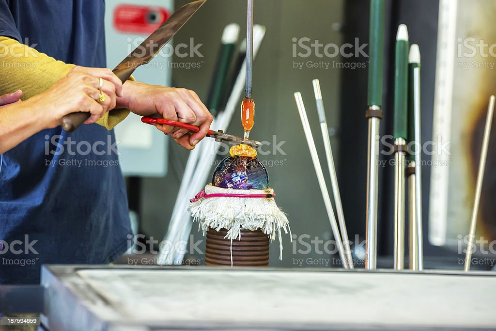 Glass blower making a Christmas ornament royalty-free stock photo
