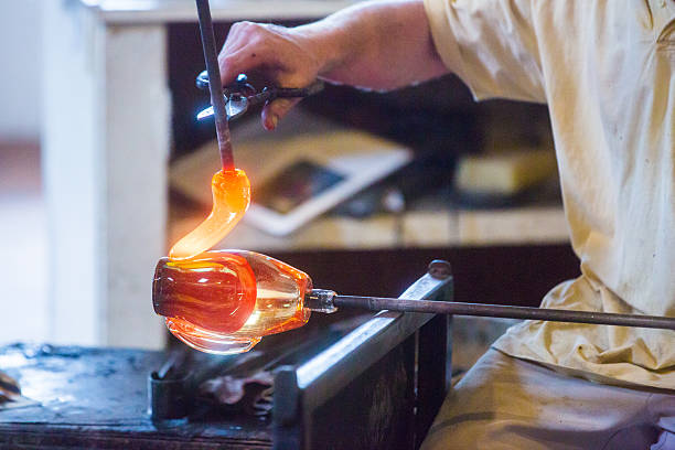Glass blowers Working in Studio stock photo