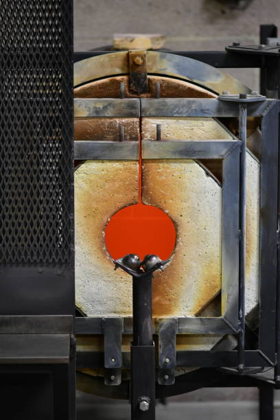 glass blowing equipment warming up - steven harrie stock photos and pictures