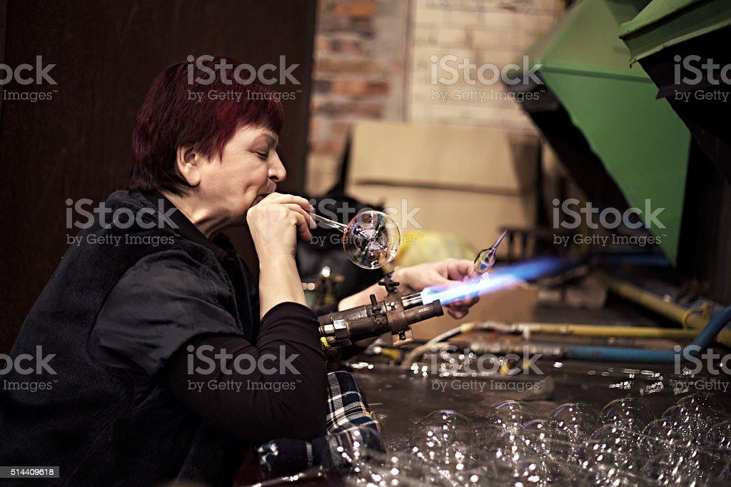 Glass blowing process stock photo