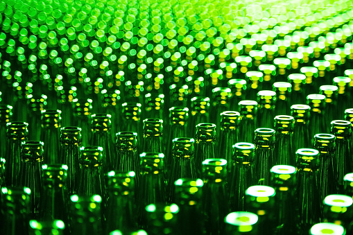 Glass bottle at factory for production of glass containers. Glass bottle texture