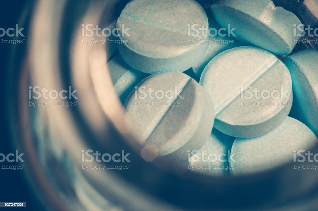 A glass bottle of pills stock photo