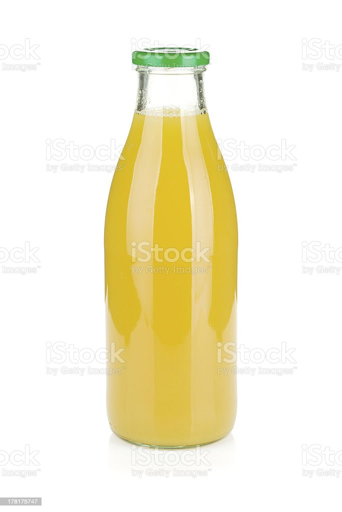 Glass bottle of pineapple juice royalty-free stock photo