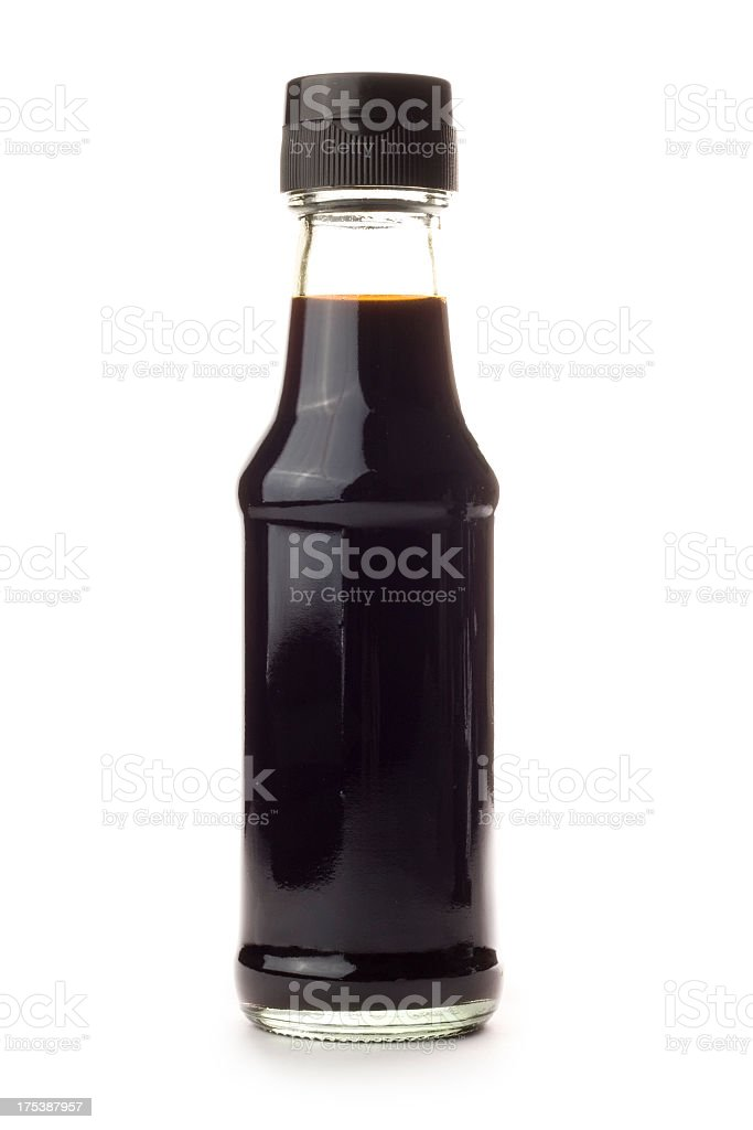 Glass bottle of Soy Sauce isolated on a white background stock photo