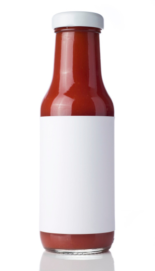 Tomato Ketchup bottle with a blank label isolated on a white background. Ideal for imposing your own artwork onto.
