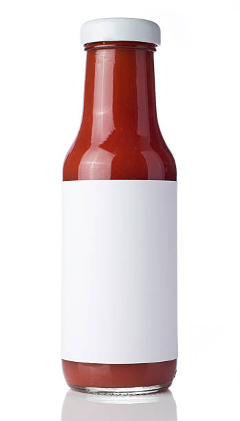 glass bottle of tomato ketchup with a blank label - saus stockfoto's en -beelden