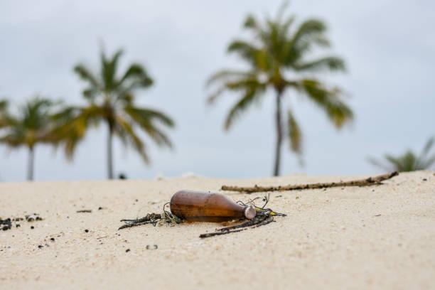 Glass bottle on the beach stock photo