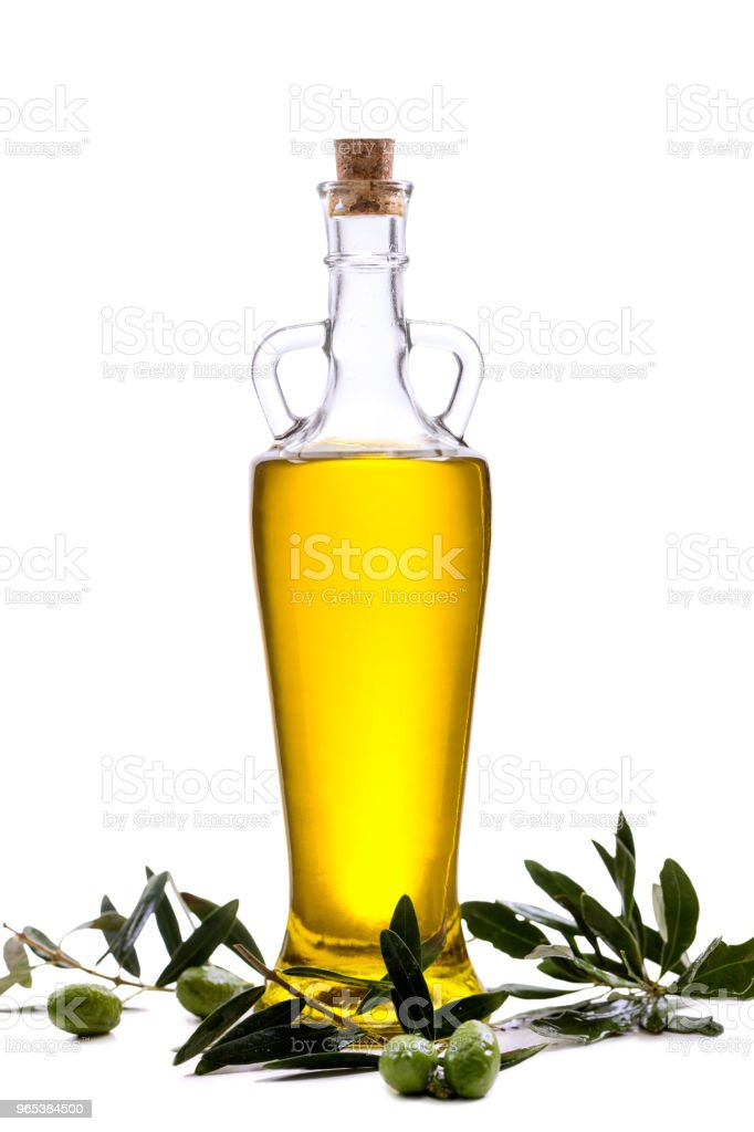 Glass Bottle with extra olive oil and olive branch isolated on a white zbiór zdjęć royalty-free