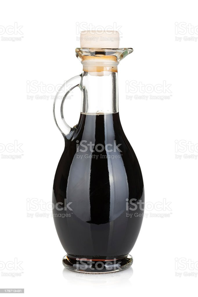 Glass bottle with handle full of black liquid stock photo