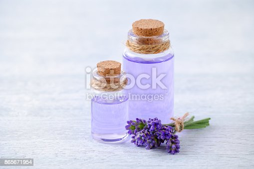 istock glass bottles aromatherapy oil and fresh lavender flowers on wooden table 865671954