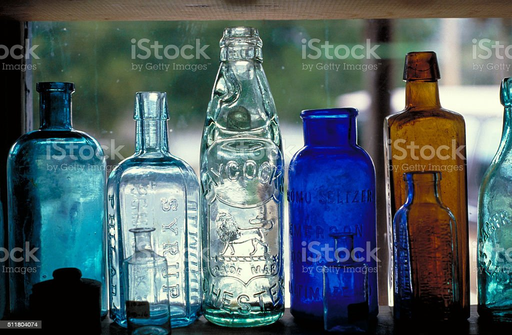 Glass Bottles in Antique Store Window stock photo