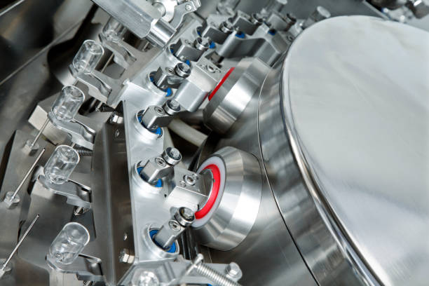 Glass bottles in production in the tray of an automatic liquid dispenser, a line for filling medicines against bacteria and viruses, antibiotics and vaccines stock photo