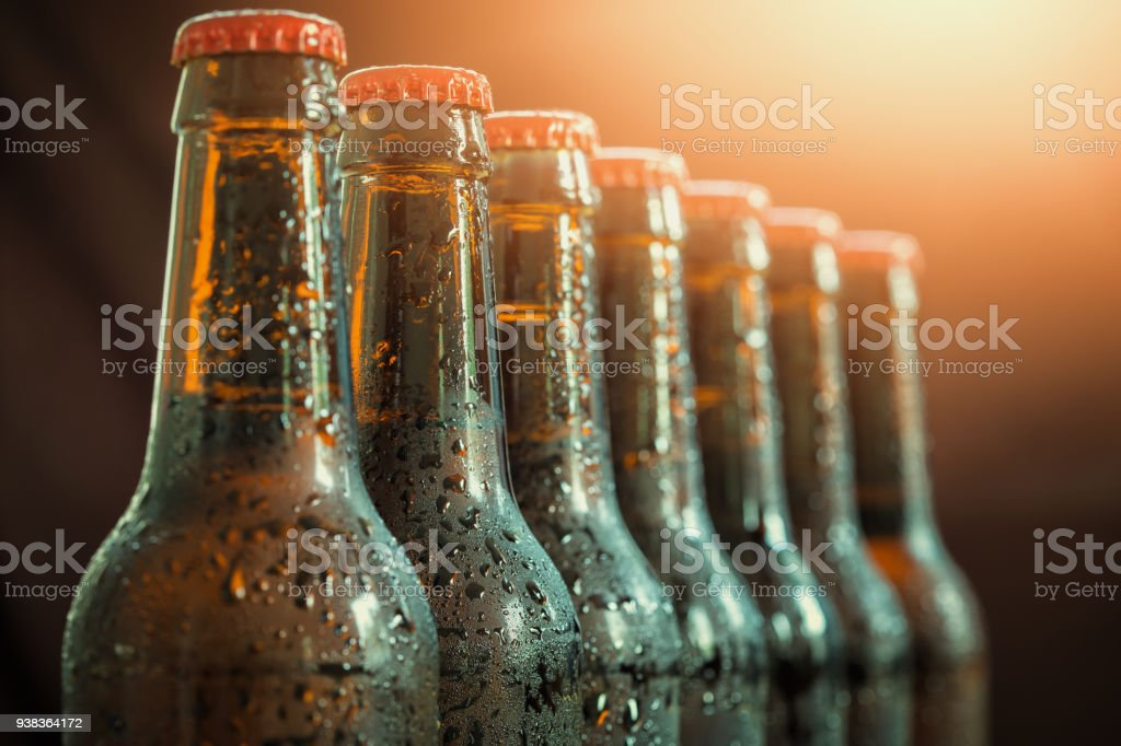 Glass bottles of beer on the dark background stock photo
