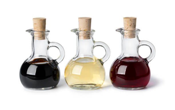 Glass bottles with different types of vinegar stock photo