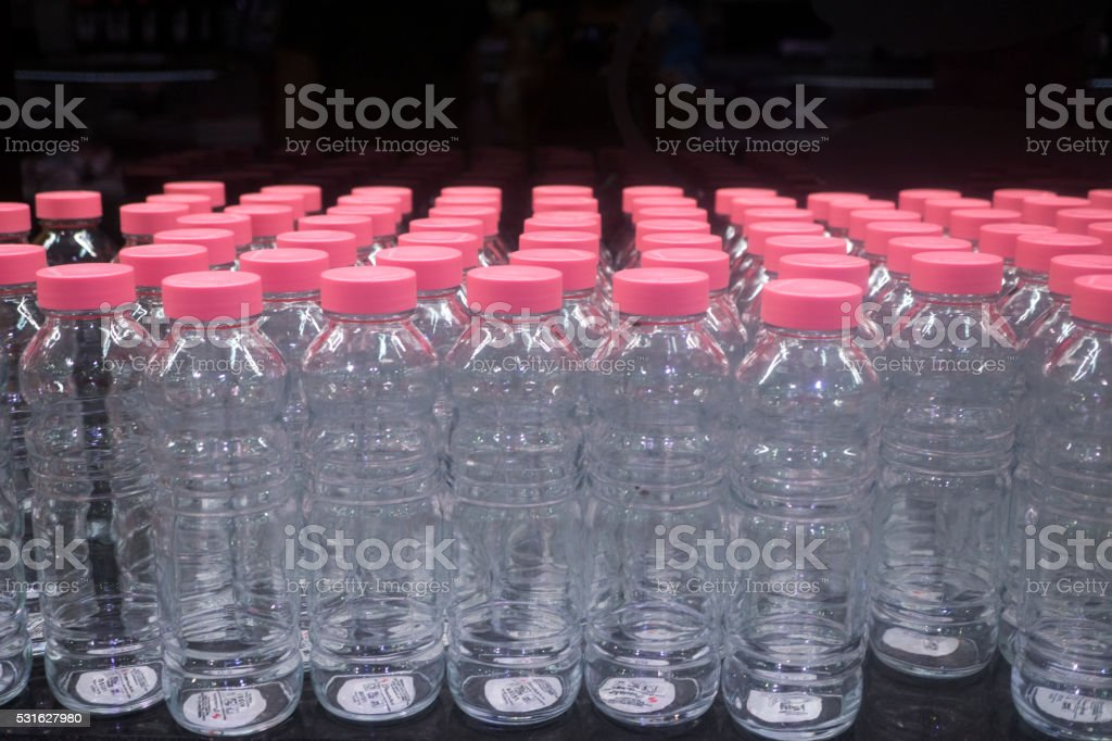 Glass Bottles with pink lids stock photo
